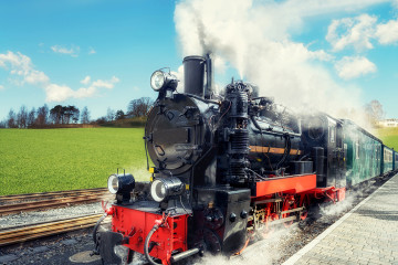 Historical steam train on island Rugen in Nothern Germany on a bright day in Spring. This image is toned.