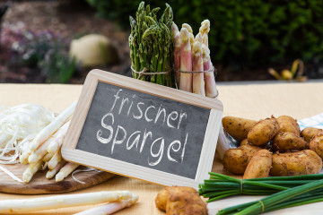 sundry Asparagus with blackboard and german words frischer spargel, means fresh asparagus